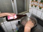 Step 7: Pour about 1/3 cup rice wine in to the liver and stir, if heat is too low may turn up heat to medium high.
